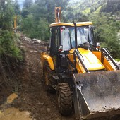 Excavator helping for road construction